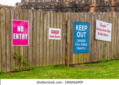 Signs advise people to keep away from an unsafe building