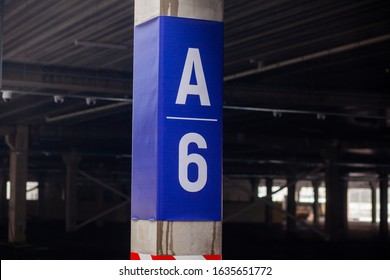 signs in a car parking near a shopping center