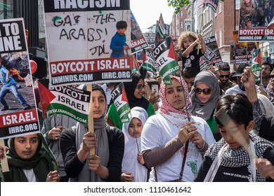 Signs depicting allegations of Israeli war crimes are on display during the Al Quds Day rally, London, 10/06/18.