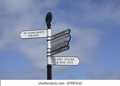 Signs with directions to different areas inside the Edinburgh Castle in Scotland