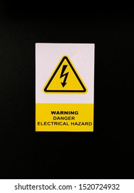 Signs of electrical hazard. It is used to warn about the dangers of electrical appliances being used to prevent an accidents. Noise and grain effects.