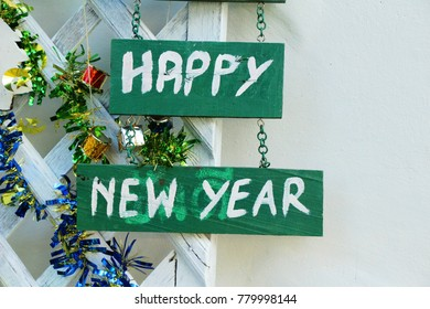 Signs is Happy New Year on wood background