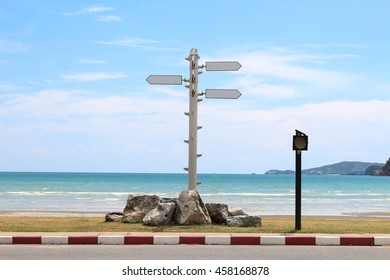 Signs on the beach, choose a travel destination.
