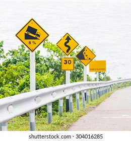 Signs on curves and slopes road beside the sea