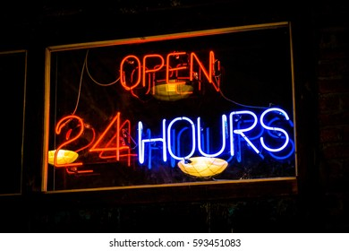 Signs open 24 hours, neon light at restaurant, food bar, modern market.
