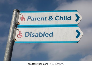 Signs for parent and child and disabled parking in a Tesco car park Warrington May 2018