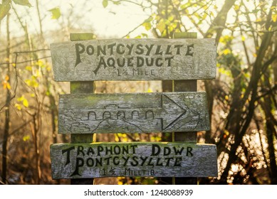 Signs for Pontcysyllte Aqueduct which is a navigable aqueduct that carries the Llangollen Canal across the River Dee in the Vale of Llangollen in north east Wales, UK