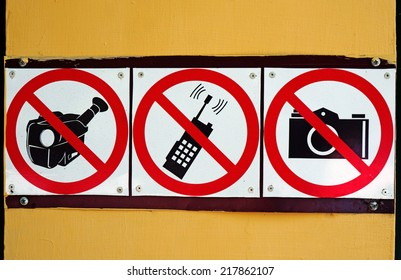 Signs prohibiting pictures, shoot video and use of mobile communication