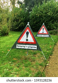 Signs is a public park in the UK warning about grass cutting and spraying