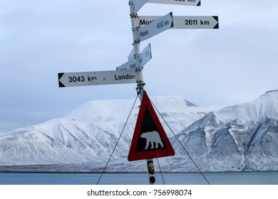 Signs with snowy mountain in the background
