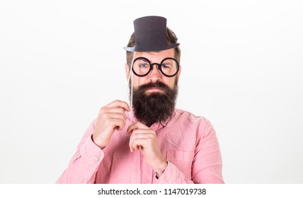 Signs someone is smarter than you. Man bearded hipster hold cardboard top hat and eyeglasses to look smarter white background. Guaranteed ways appear smarter. Tricks to seem smarter than you are.
