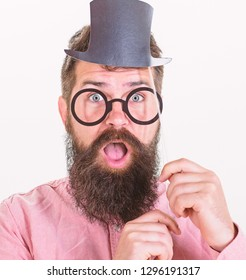 Signs someone is smarter than you. Tricks to seem smarter than you are. Guaranteed ways appear smarter. Man bearded hipster hold cardboard top hat and eyeglasses to look smarter white background.