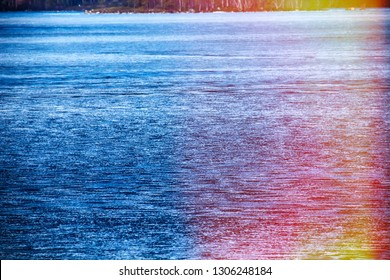 Signs of spring for Earth watchers, Earth observers. Snow on the ice lakes saturated with water and blue. Forest lake in Lapland and the sun's rays