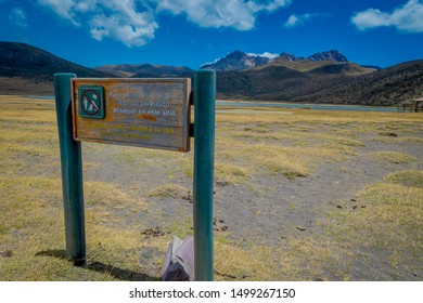 Signs for tourist at Cotopaxi national park, Ecuador in a sunny and windy day