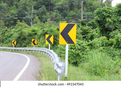 Signs warning of the curve