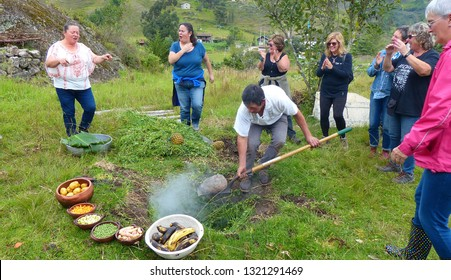 Sigsig, Azuay, Ecuador - February 22, 2019: The pachamanca is an ancestral cooking process, part of ritual of indigenous of the Andes and traditional food. Tourists participate in traditional ritual.