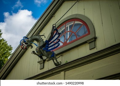 Sigtuna, Sweden 14/09/2018: A sign in the shape of a dragon found hanging from an old house in Sigtuna, Sweden.