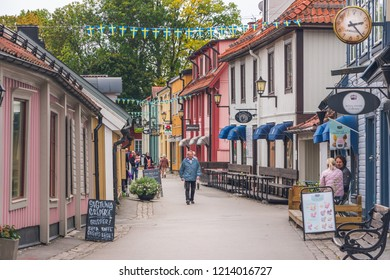 Sigtuna, Sweden -September 23, 2018: view of beautiful colorful buildings on Stora Gatan street in heart of old town. Founded in 980 Sigtuna is the oldest city in Sweden, a popular tourist destination