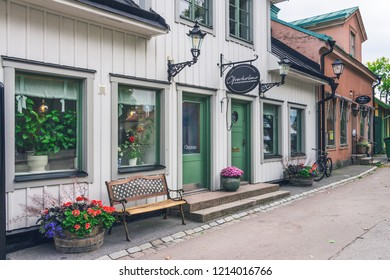 Sigtuna, Sweden -September 23, 2018: view of an old real estate agency on Stora Gatan street in heart of old town. Founded in 980 Sigtuna is the oldest city in Sweden, a popular tourist destination.