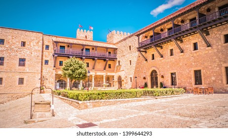 Siguenza, Castilla-la-Mancha / Spain - 04 27 2019: Main entrance at the medieval castle in Siguenza, Guadalajara province in Spain near Madrid. Beautiful, old and medieval castle in Spain