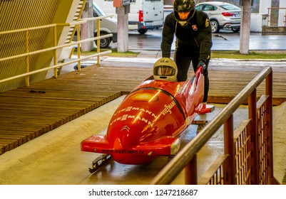 Sigulda / Latvia - Dec 2015: Two sportsmens have training in the Sigulda Bobsleigh and Luge Track. Winter in Baltic States.