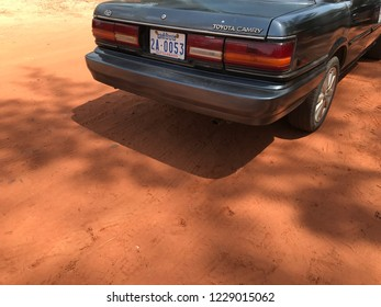 Sihanoukville / Cambodia - 02.19.2017 : Old Toyota Camry car parked on the red dry muddy road in Cambodia