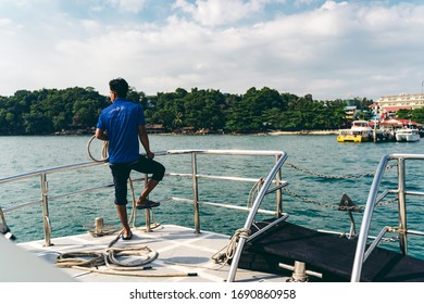 Sihanoukville / Cambodia - 12/06/2018: Man in the front of ferry is ready to moor