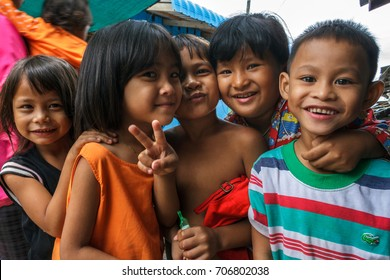 SIHANOUKVILLE, CAMBODIA - 7/20/2015: A group of children play in the streets of their fishing village.