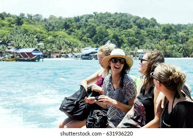 SIHANOUKVILLE, CAMBODIA - APRIL 15, 2017: the group of tourists taking a ferry boat to koh rong island