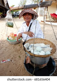 SIHANOUKVILLE, CAMBODIA - CIRCA AUGUST 2012 : A CAMBODIAN WOMAN SELLING BALUTS