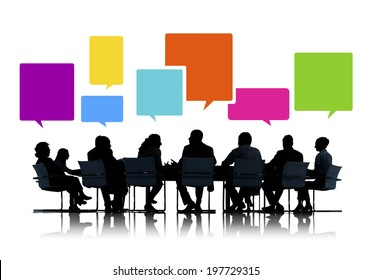 Sihouettes of Business People in a Meeting with Speech Bubbles