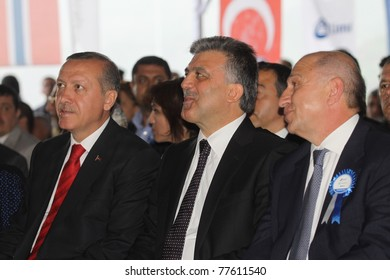 SIIRT, TURKEY - MAY-19:  Prime Minister Tayyip Erdoan, President Abdullah Gül and Contractor Nihat Ozdemir attend the Alkumru Hydroelectric Power Plant Santral opening on May 19, 2011 in Siirt, Turkey.