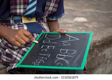 Sijhora,Madhya pradesh,India,September 21, 2019:The handwriting of the little girl on the roof abcd on a small black board.