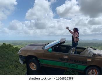 Sijuk, Bangka Belitung Islands / Indonesia - February 29 2020: Photo Spot of Belitung Flying Car on Peramun Hill (Photo-shoot di Mobil Terbang Belitong, Bukit Peramun)
