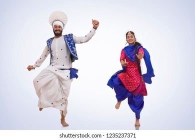 Sikh Couple Doing Bhangra Dance