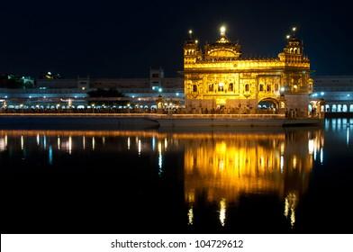Sikh Golden temple Harmandir Sahib in Amritsar at night, Punjab, India .