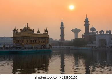 Sikh gurdwara Golden Temple (Harmandir Sahib) on sunrise. Amritsar, Punjab, India