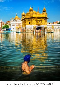 The Sikh prayer in the lake of Harmandir Sahib, or Golden Temple, Amritsar, India