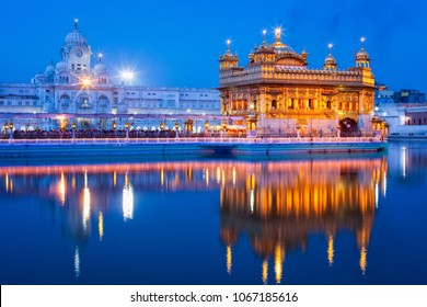 Sikh sacred site gurdwara Sri Harmandir Sahib (also known as The Golden Temple, also Darbar Sahib) illuminated at night. Amritsar, Punjab state, India