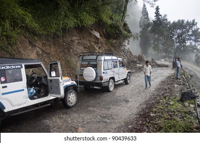 SIKKIM, INDIA - AUGUST 17: Stuck POVs because of landslide on August 17, 2011 in Sikkim, India. During the monsoon (between June and September), heavy rains increase the risk of landslides.