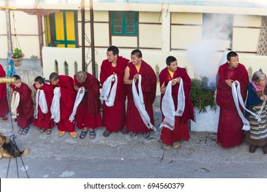 SIKKIM, INDIA. DECEMBER 30, 2015: Tibetan monks bowing with frankincense smoke for welcoming high level monk in area of Rumtek Monastery near Gangtok. Sikkim, India