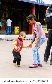 SIKKIM, INDIA - MAR 13, 2017: Unidentified Indian little girl and boy play on the street.