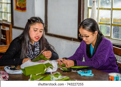 SIKKIM, INDIA - MAR 13, 2017: Unidentified Indian woman sews with a help of threads.