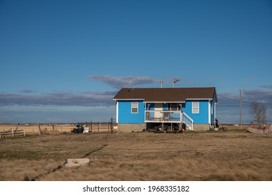 Siksika Nation, Alberta - May 2, 2021: House on the Siksika Nation reservation in Alberta. Housing is a concerning issue for many First Nations people ion the Canadian prairies.