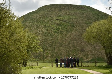 Silbury Hill, Wiltshire/ UK - April 26th 2018 : Tourists gather to view Silbury Hill in Wiltshire. The Neolithic site is famous throughout the UK and Europe.