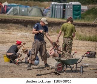 Silchester, Hampshire, England - July 18 2013 : Archaeologists excavating (digging) Roman town of Calleva Atrebatum