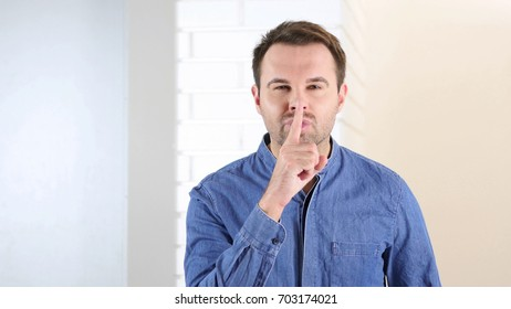 Silence Gesture by Middle Aged Man