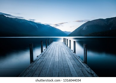 Silence pier on the blue lake between mountains