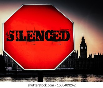 Silenced written on a sign withHouses of Parliament, London in background - dystopian theme due to political uncertainty as a result of prologation of parliament