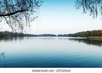 Silent coastal landscape. West Lake park in Hangzhou city center, China